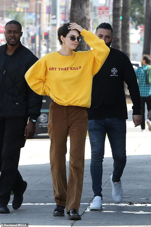 Kendall Jenner wears yellow 'art that kills' sweater in Los Angeles – Street Style