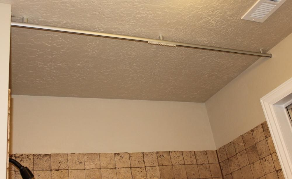 Ceiling mounted shower curtain rod bathroom pinterest for Ceiling mounted sliding panels