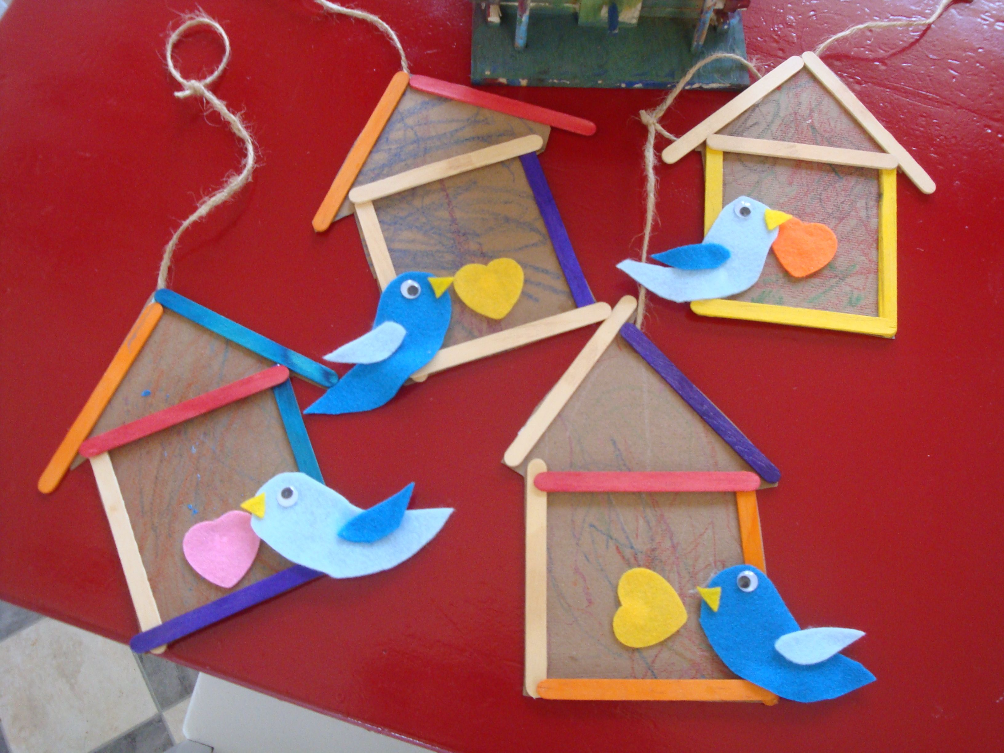 popsicle stick birdhouse from the playful garden kids art and