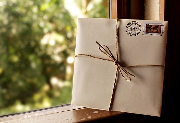 For a travel-themed wedding, send out invites like mini parcels, tied with paper twine and stamped with an airmail etiquette with the couple's names and wedding date.