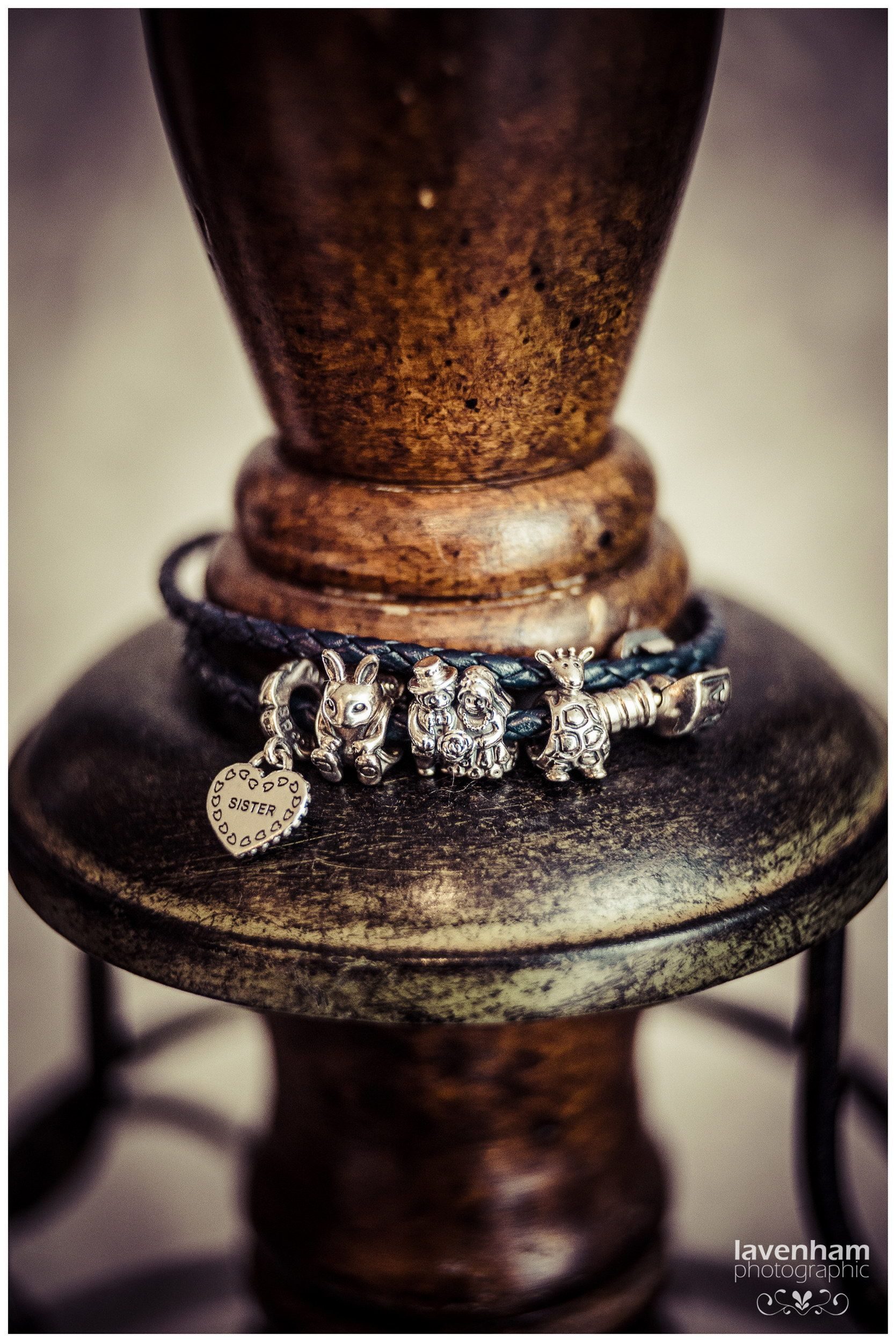Bride's Pandora Bracelet, gift from her sister, Easter wedding. Charms include Sister, Easter bunny, bride and groom. Photographed on wooden dressmaker's mannequin