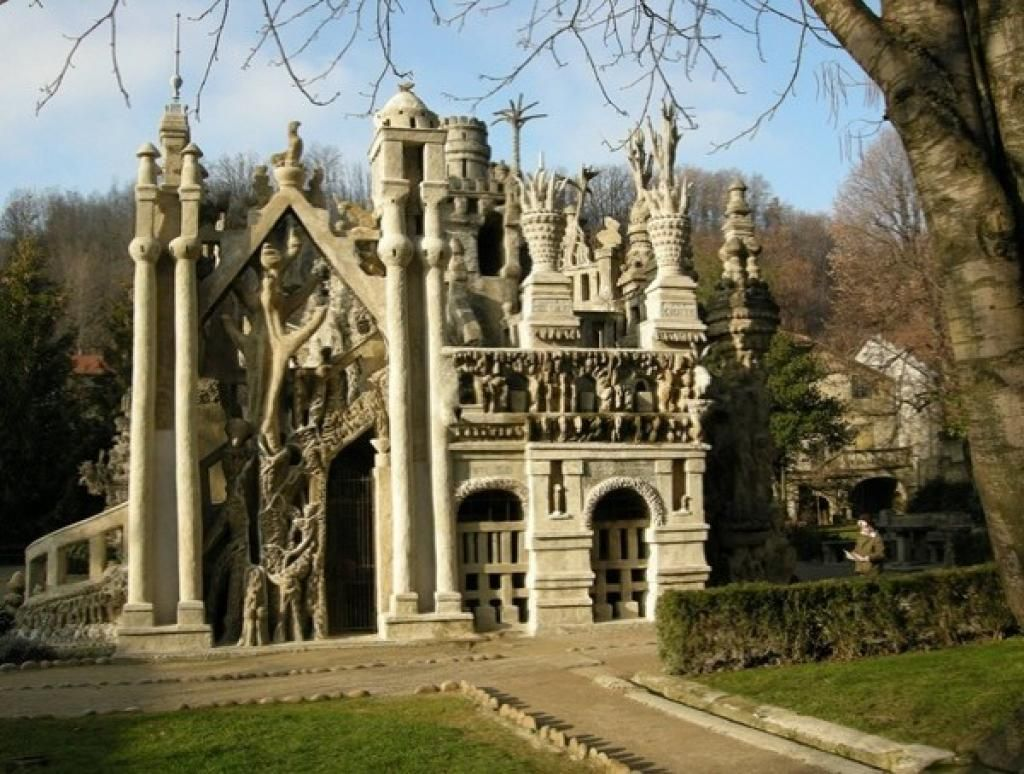 "Now I am lovin' this! Ferdinand Cheval was a French postman who spent thirty-three years of his life building Le Palais idéal (the ""Ideal Palace"") in Hauterives  For thirty-three years, he picked up stones during his daily mail round and carried them home to build the Palais idéal.  His story of why he built this house is a charming one.  He also built a mausoleum where he was buried about a year after it was finished.  For more go to: http://en.wikipedia.org/wiki/Ferdinand_Cheval"