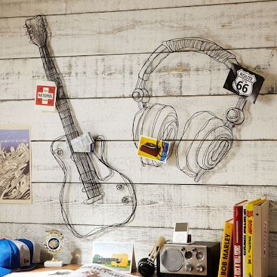 """Sturdy metal wire is artfully shaped in a mix of twists, loops and lines to re-create two of the music lover's favorite things. The sculptural design brings dimension to these rocking wall displays."""