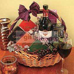 Fresh fruits with wine  A large wicker basket of delectable gourmet delights is a special gift for VIP. Gourmet includes: Red wine, frest fruits, Swiss chocolates, ...