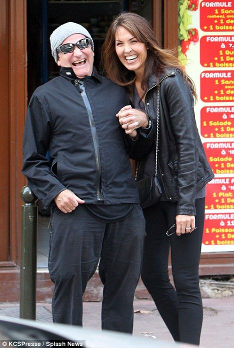 Happiness: The comedy actor and his wife couldn't stop smiling and laughing.  Sadly, it wasn't enough to save him.
