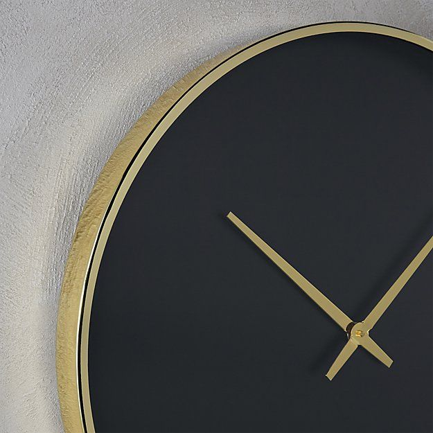 Shop solitaire black and gold wall clock.   Rimmed in a shiny circle of gleaming gold, metal wall clock is perfectly timed with the trend.  Sophisticated quartz movement tells time on a sleek black face while shiny gold hands tick away the minutes.