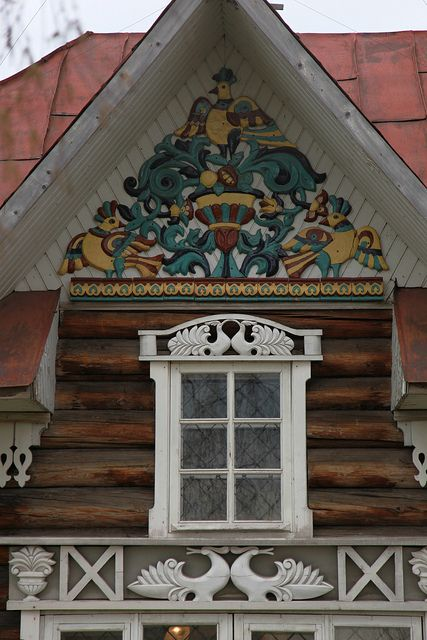 Russian wooden house with carved decorations.