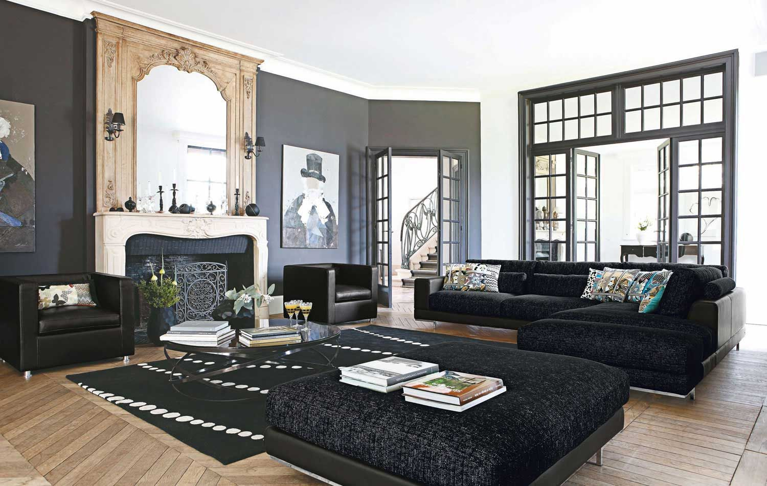 calm living room interior with l shaped black sofa completed and