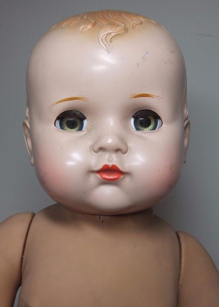 Baby Doll with Hard Plastic Head on a Magic Skin Body