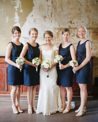 The 'maids donned navy knee-length dresses from The Limited and champagne heels in this DIY Wedding in Milwaukee.