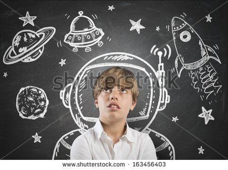 Child who dreams of being in space with open eyes - stock photo