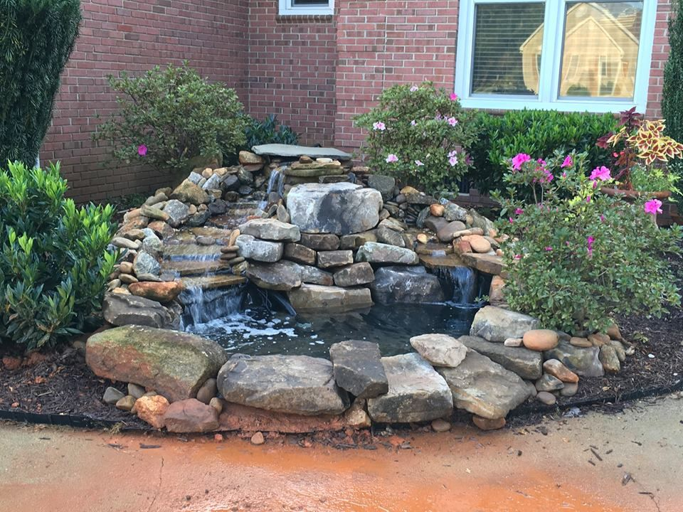 small pond with falls. Designed and installed by