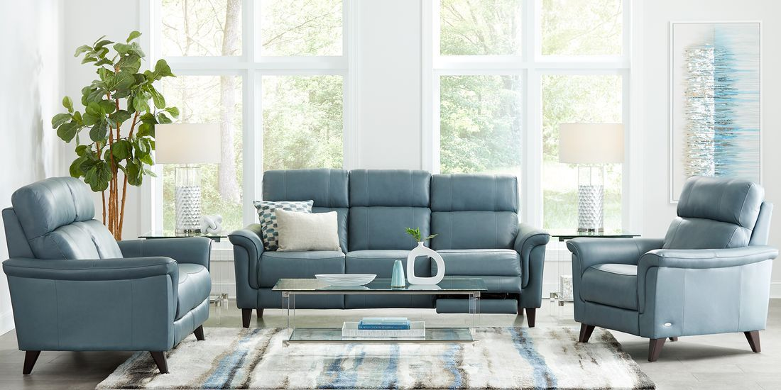 Cindy Crawford Home Avezzano Blue 7 Pc Leather Living Room With Dual Power Reclining Sofa Living Room Sets Furniture Living Room Leather Living Room Sets