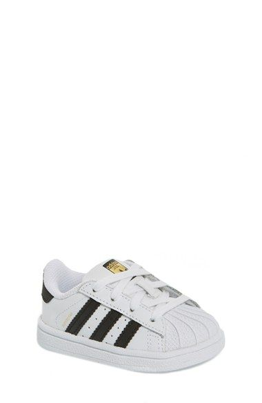 d05f95227fd94 Free shipping and returns on adidas  Superstar  Sneaker (Baby, Walker    Toddler) at Nordstrom.com. A trio of signature stripes amps up the  old-school appeal ...