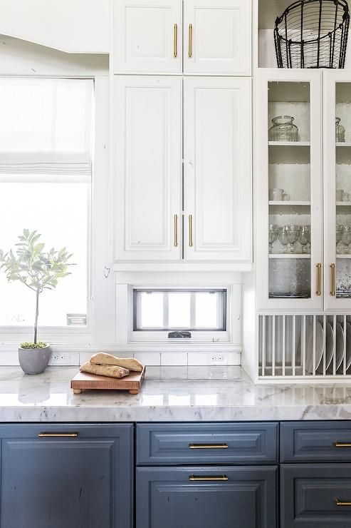 A Built In Plate Rack Sits Under White Top Cabinets That Include
