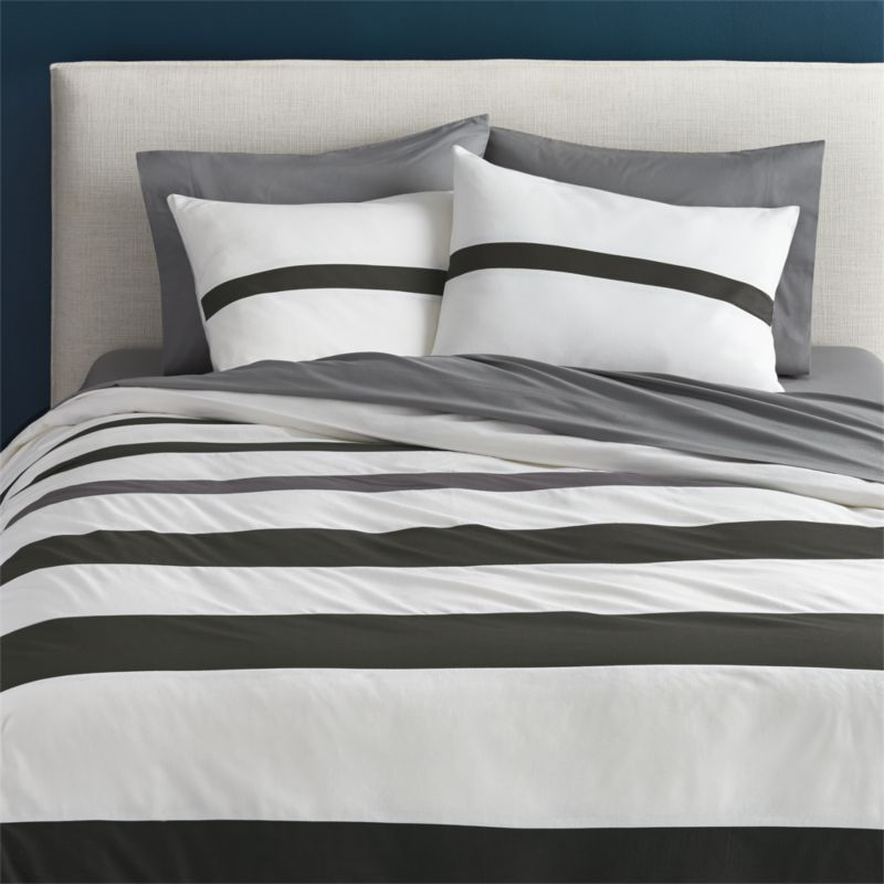 lay it on the line.  Black bands run clean, classic horizontal stripes, gradiating in width from head to toe.  One dark grey stripe adds unexpected contrast atop off-white background.  Duvet cover has nonslip corner ties and hidden button closure; reverses to solid off-white.  Dreamy with single-striped shams. Cotton/linen; pieced constructionMachine wash cold.