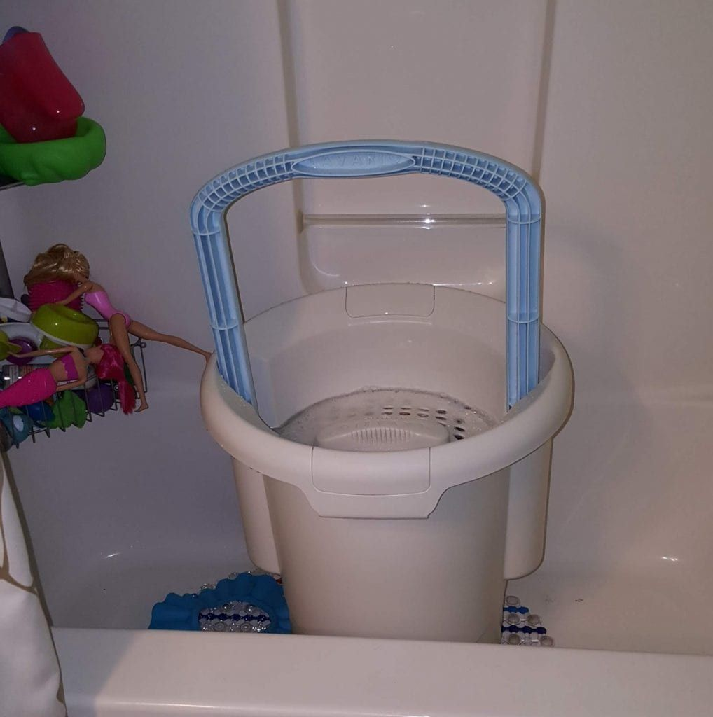 Hand washing cloth diapers in a lavario portable clothes