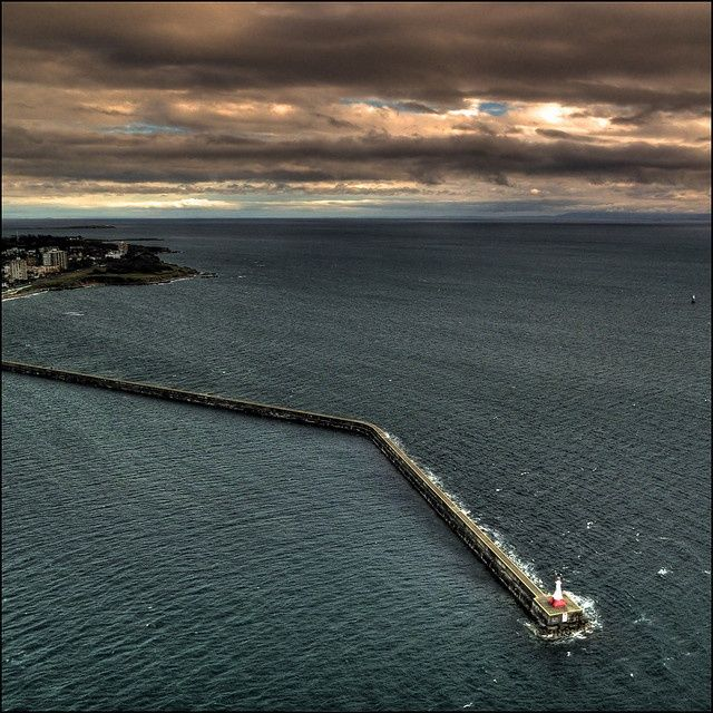 The lighthouse on breakwater, Victoria, BC, Canada.