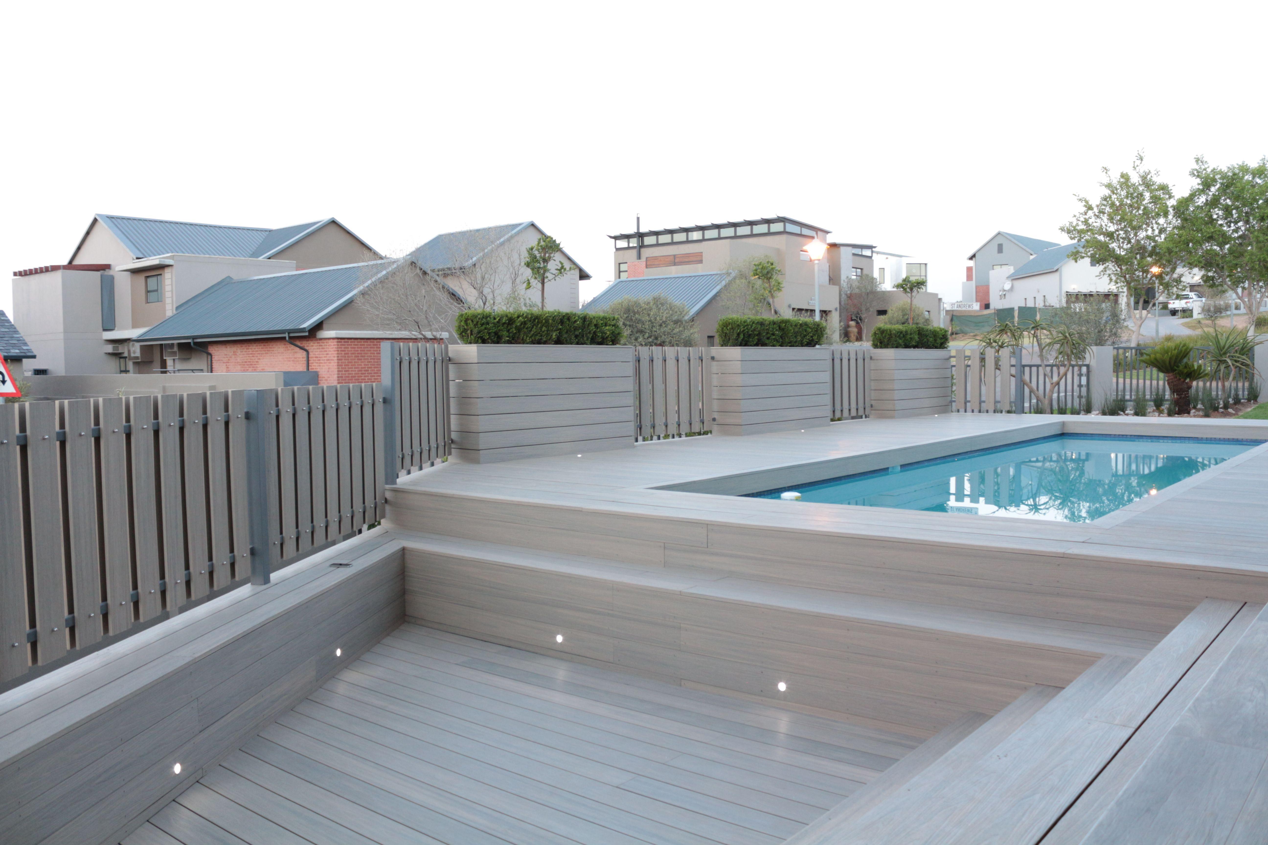 Sleek and elegant outdoor pool area created with newtechwood