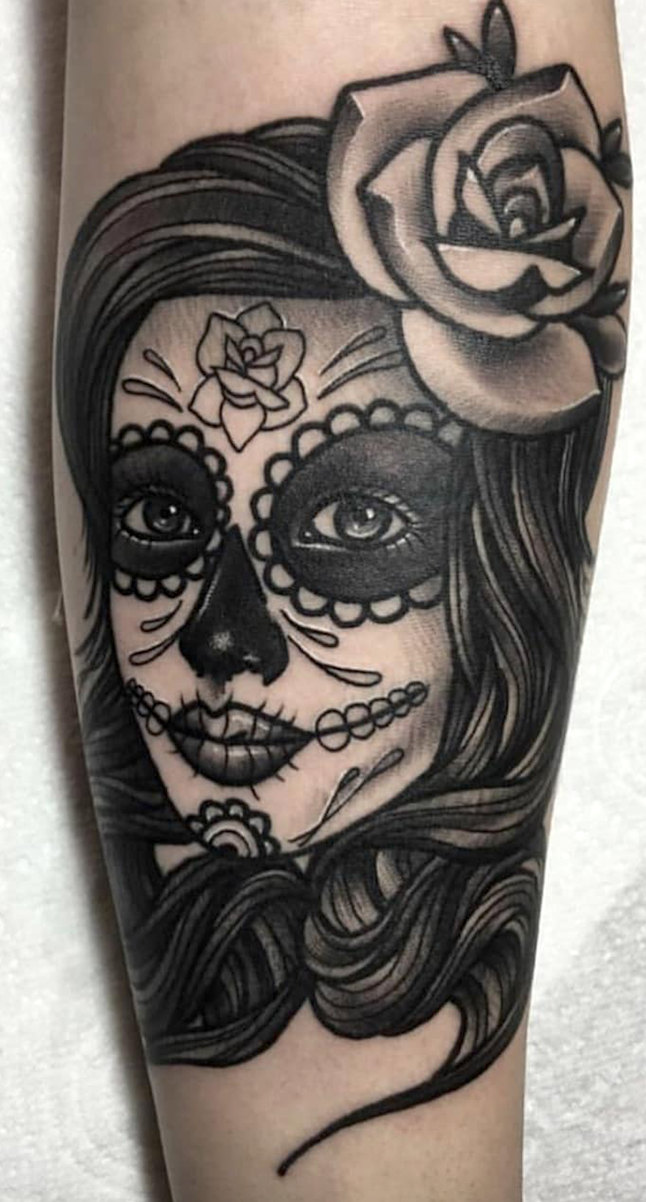 20 Day Of The Dead Tattoos That Will Inspire You To Celebrate Life Thinking About Getting A Skull Tattoo Give A Latin And Tatuajes Sombra Negra Santa Muerte