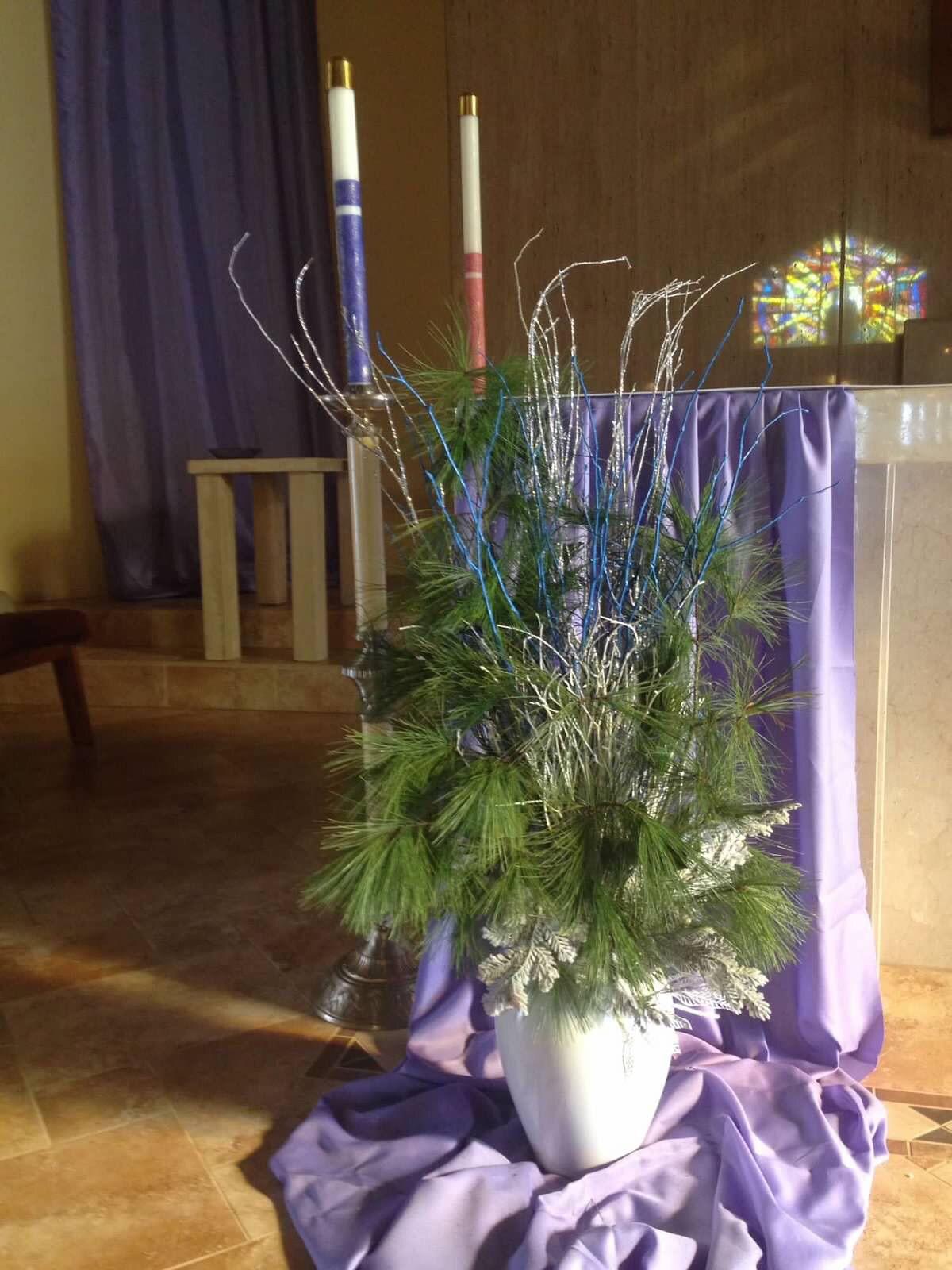 Church altar decor fabric and vase of fresh greens