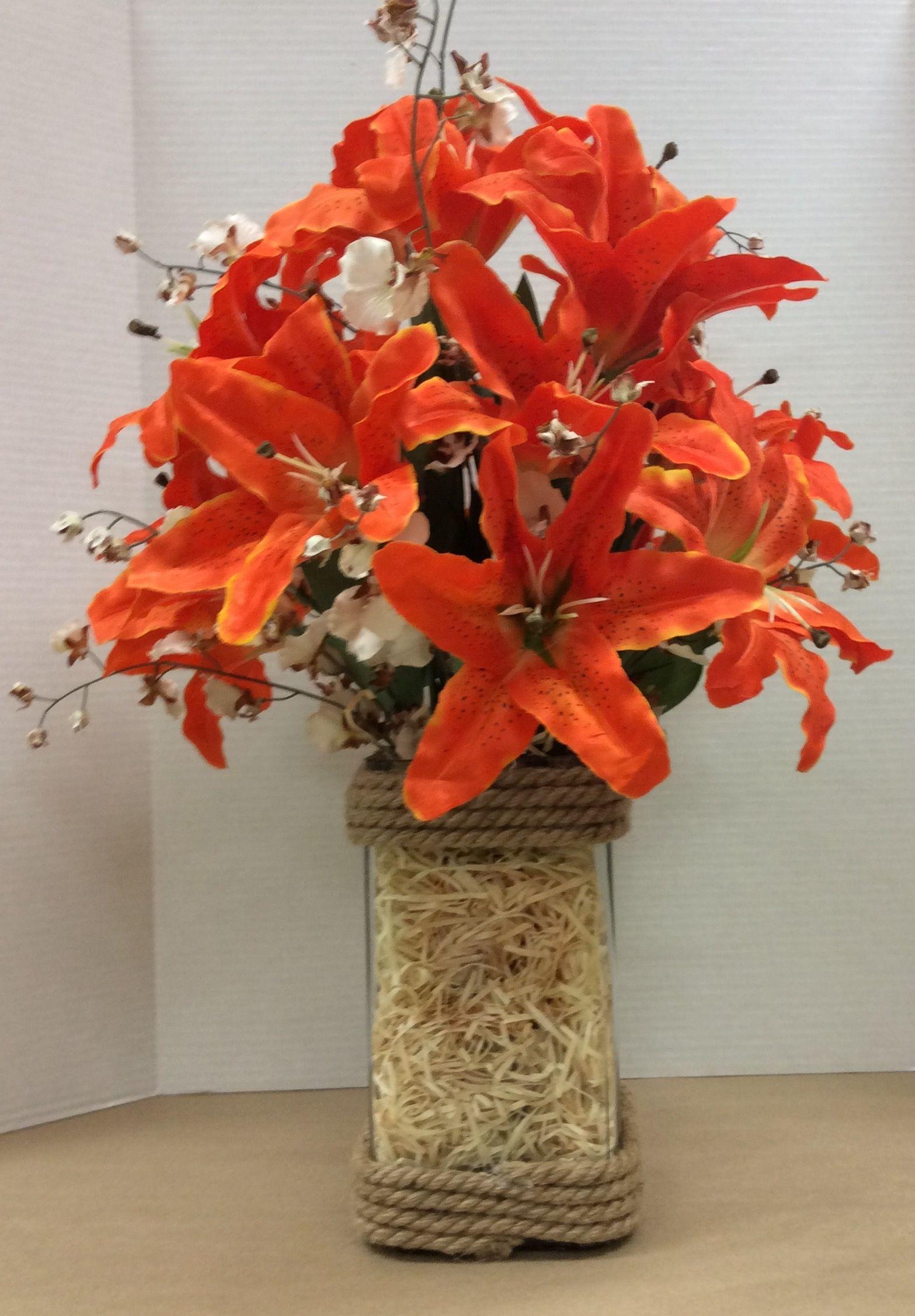 Floral Design I Made Using Glass Vase With Jute Glued To Top And Bottom Glued Styrofoam Inside Added Excelsior To Cover Foam Floral Floral Design Deco Mesh
