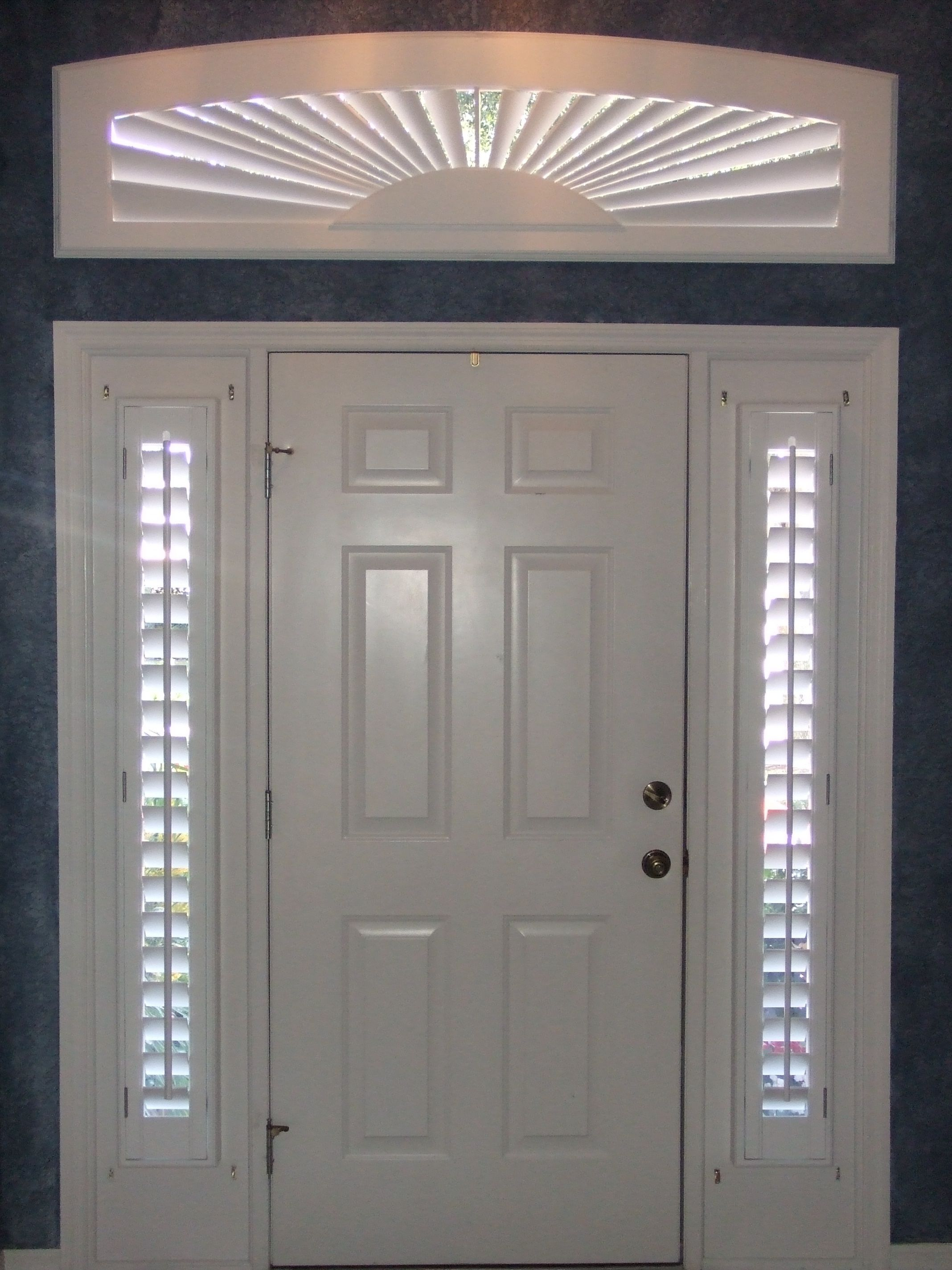 Shutters can be made to cover nearly any window shape like this arch