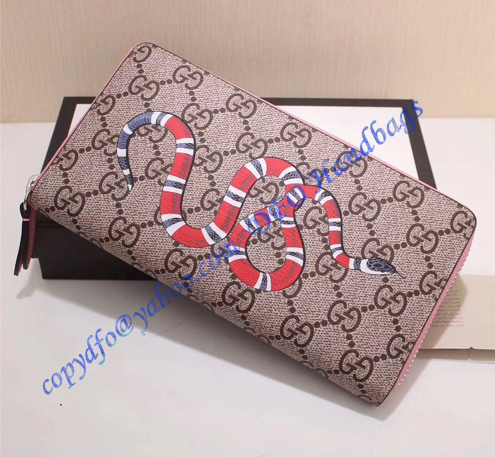 90a233367ba Gucci Kingsnake Print GG Supreme Zip Around Wallet with Pink Leather Trim