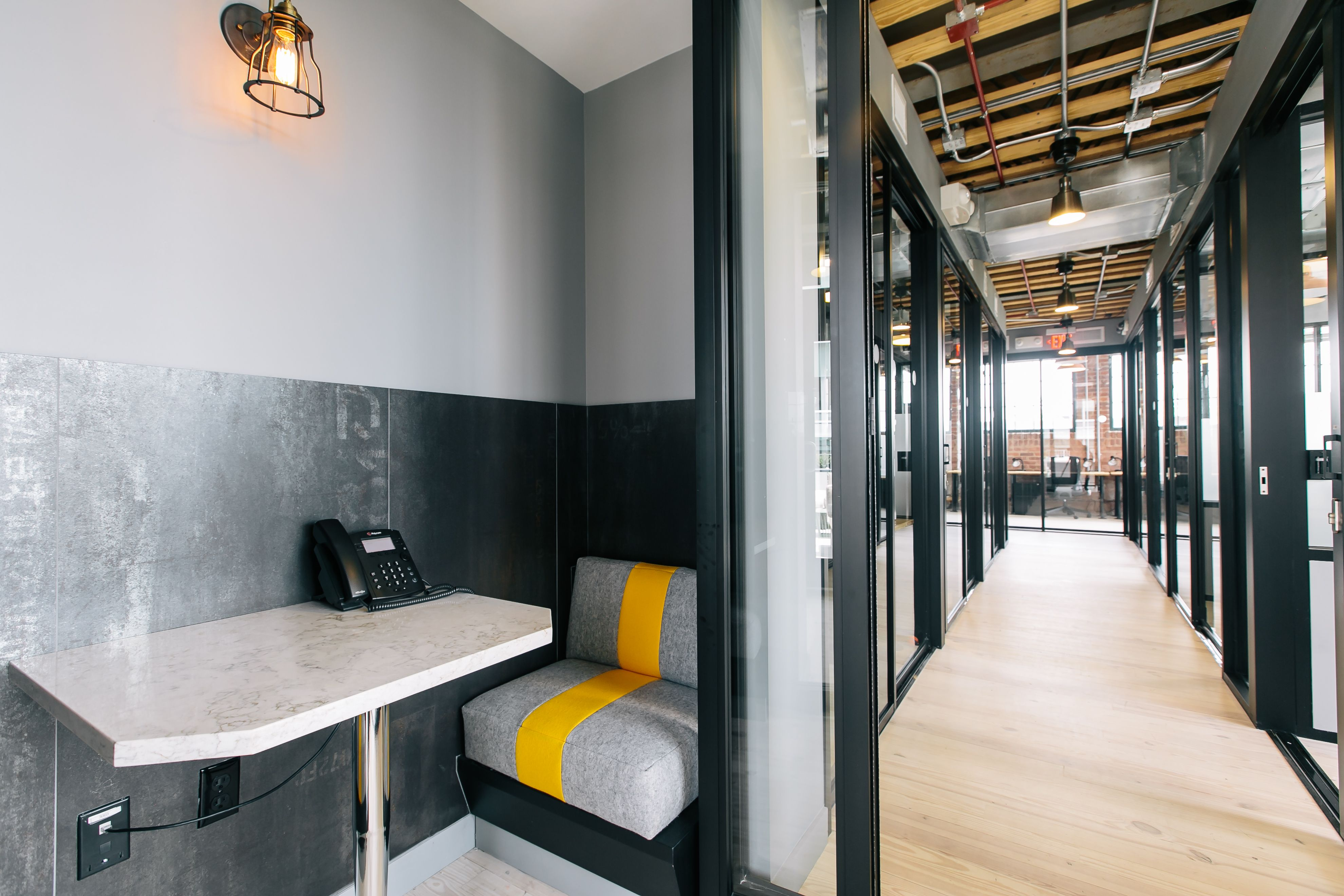 wework wonder bread phone booth imagery office lighting office interiors shared office. Black Bedroom Furniture Sets. Home Design Ideas