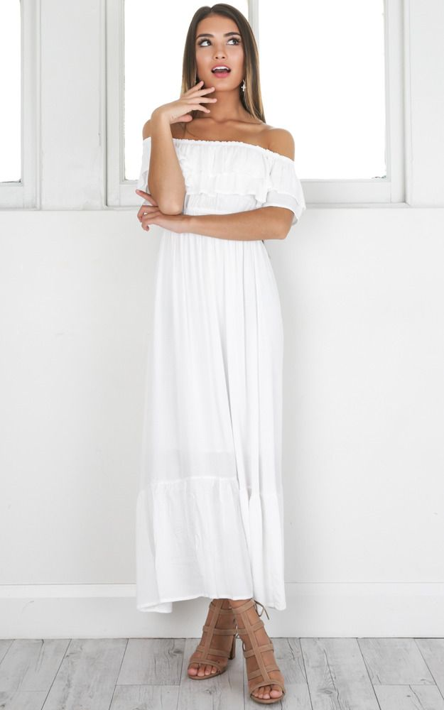 ba5aa337d686 This white off the shoulder dress is perfectly girly and flowy, ideal for  the warmer months. Style with brown sandals and a shoulder bag
