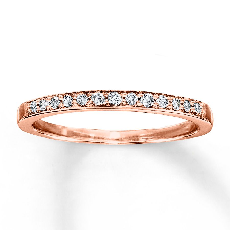 Rose Gold Wedding Band Paired With A Simple White And Diamond Engagement Ring