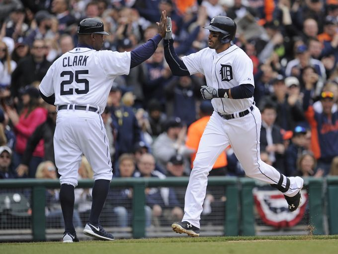 The Tigers J.D. Martinez high fives third-base coach after home run - Game 1 of 162 - Tigers 4 - Twins 0.