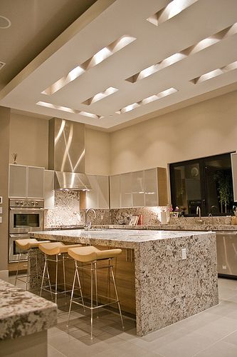 This kitchen is amazing! Love the island, stools, and gorgeous ceiling detail