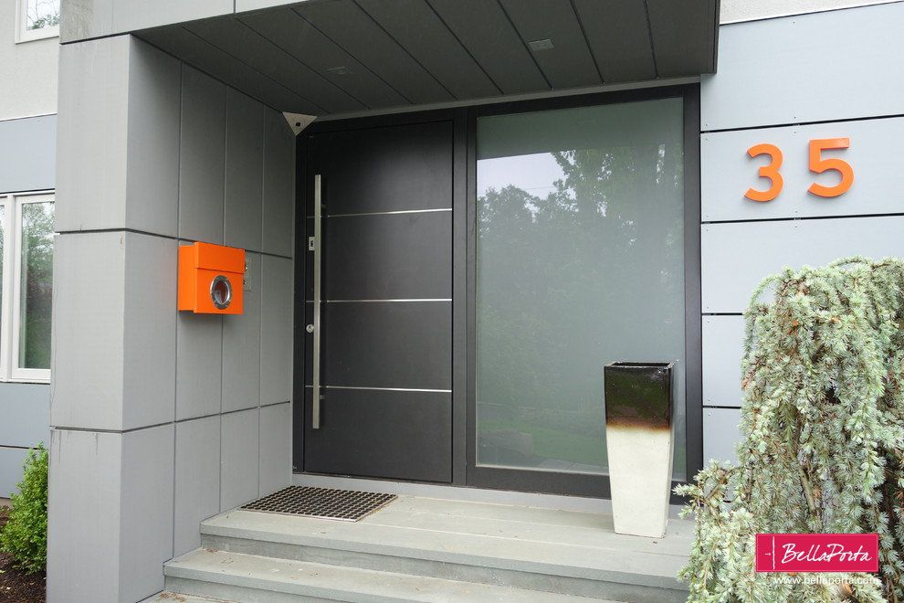 . Ultra modern front door in gray metallic finish with large sidelight