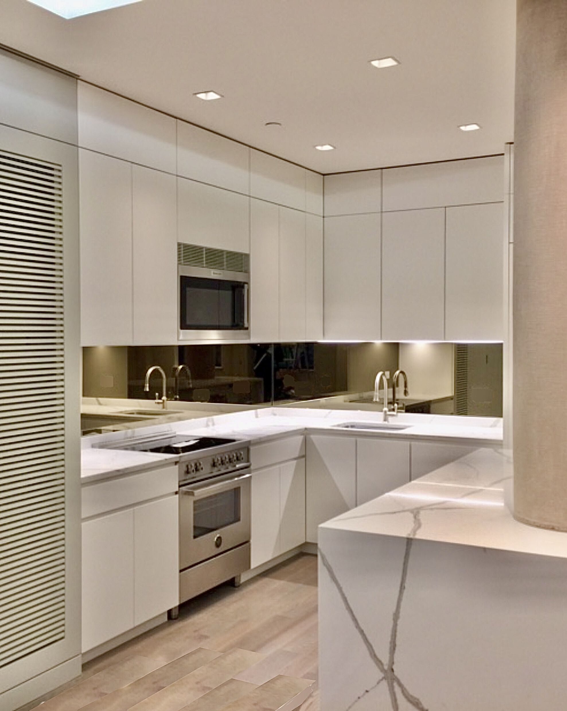 Kitchen - modern cabinetry with finger pulls for ...