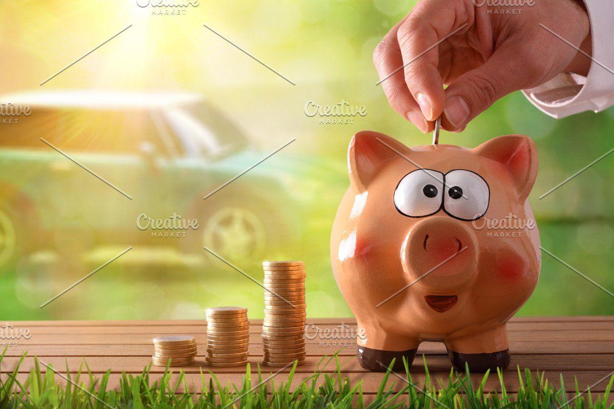 Hand putting money into piggy bank in 2020 piggy bank