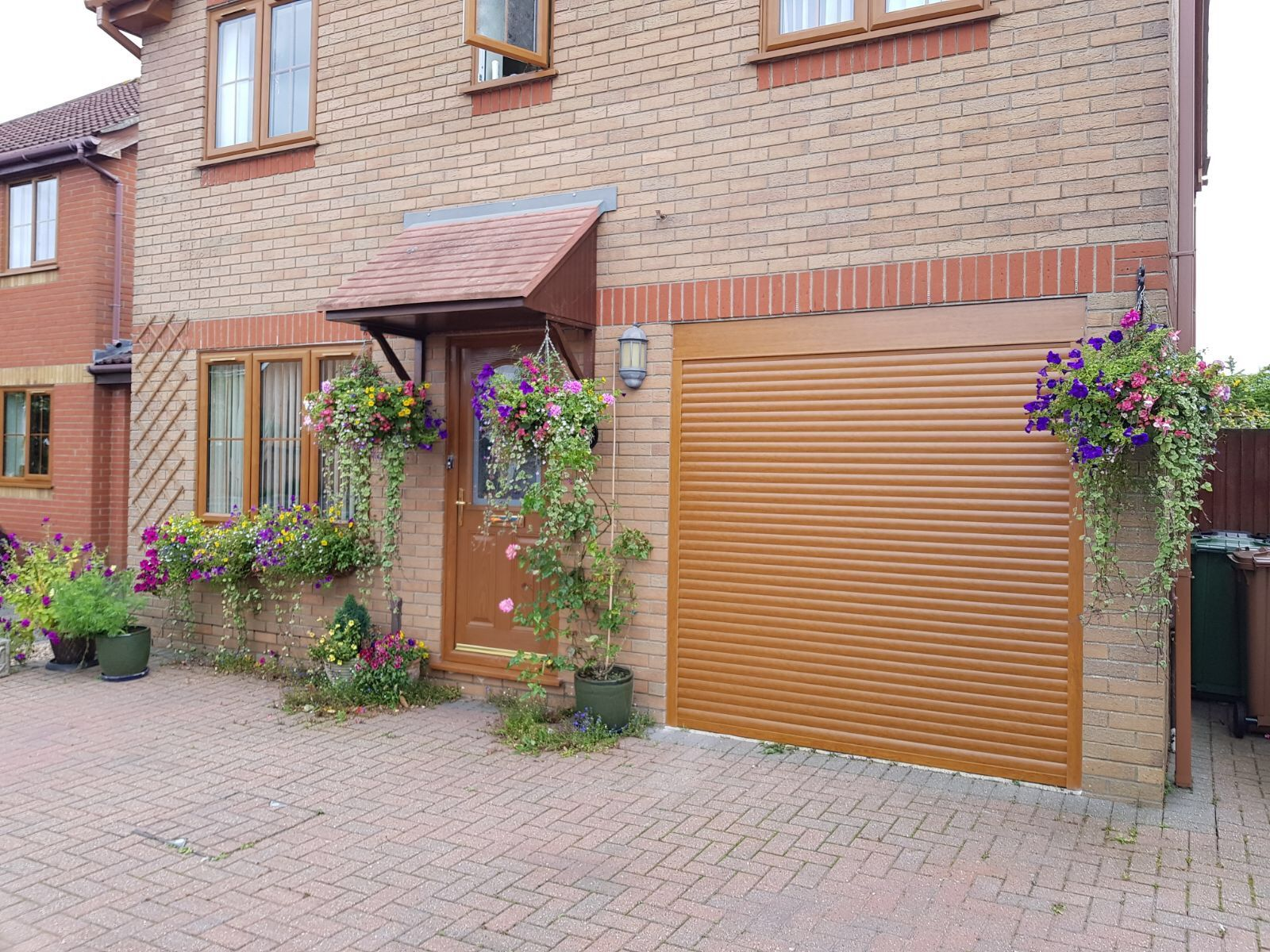 Golden Oak insulated roller garage door Garage door