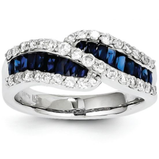 Set in 14-karat white gold, genuine Blue Sapphires are set between 2 sparkling rows of diamonds along the band.    The total diamond weight in this ring is 0.600-carats.