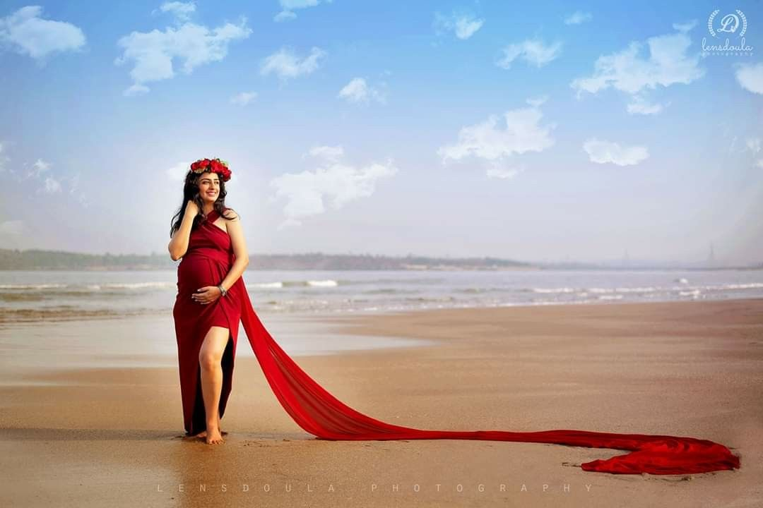 Pin By Lensdoula Photography On Red Dress Maternity Shoot On The Beach Maternity Dresses Red Dress Red Formal Dress