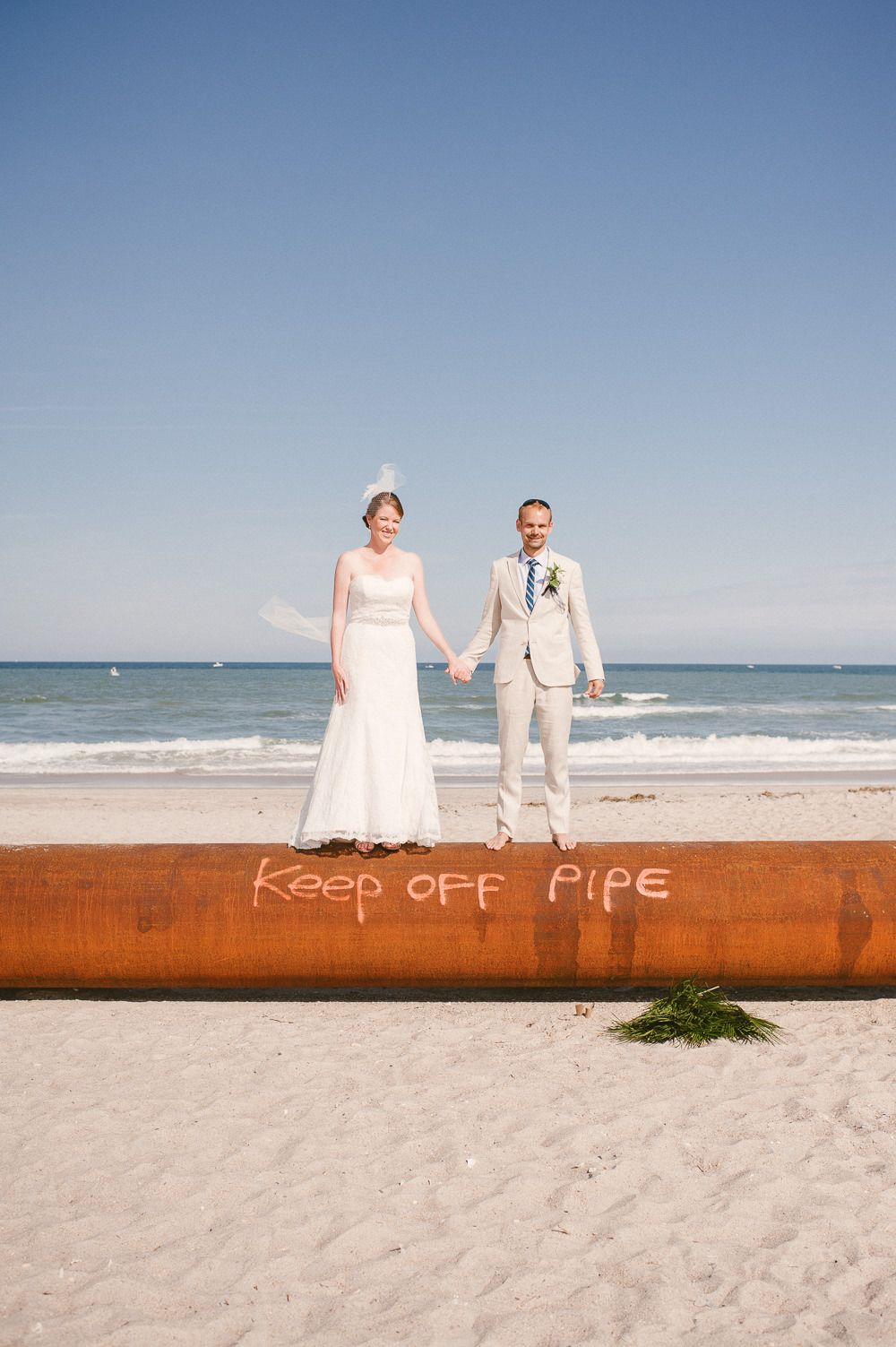 Bride wears a strapless Watters lace wedding dress at a destination ...