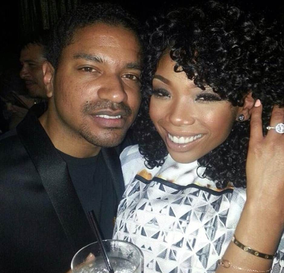 Brandy Norwood And Fiance Ryan Press Large Round Diamond In A Halo On A Pave Band Celebrity Engagement Rings Engagement Celebration Engagement
