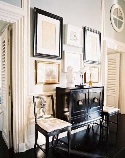 Hallway or entryway- black lacquered cabinet, black gloss chairs ...