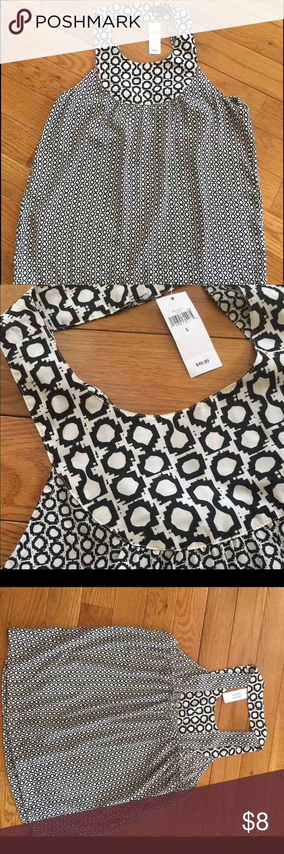Banana Republic Black and White Tank Banana Republic black and white tank. Never worn, with tag still on. Re-posting since is doesn't fit me. 100% polyester. Banana Republic Tops Tank Tops