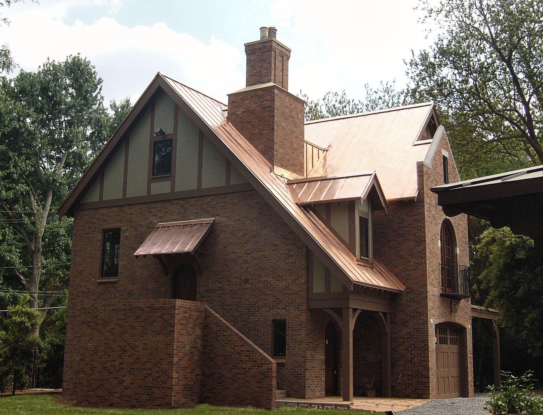 Copper Is One Of The Most Popular Metals For Roofing Even Though It Is Expensive Its Classic Look And Long Lasting Durability Copper Roof Tudor House Roofing