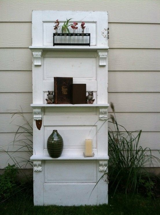 ideas for old glass door knobs | an old door with some shelves added so simple yet so effective