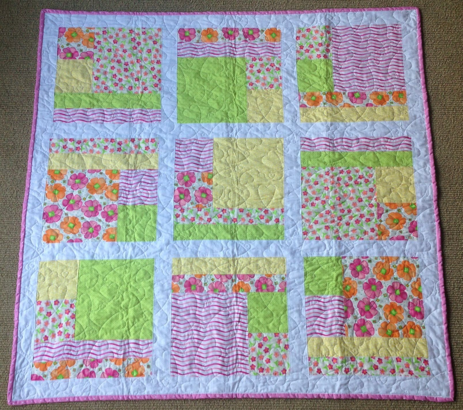 My first quilt. Lovely bright colours for a little girl. Moda Twirl fat quarters used.