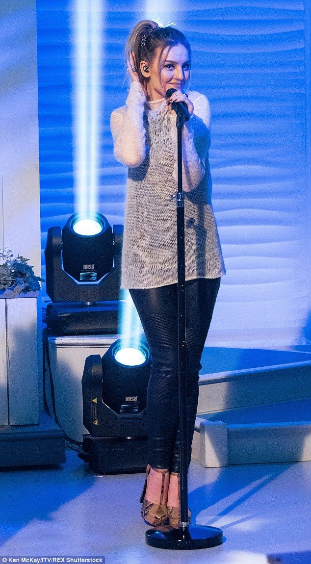 'Tis the season! Perrie Edwardshighlighted her long legs in leather trousers for the performance on Lorraine