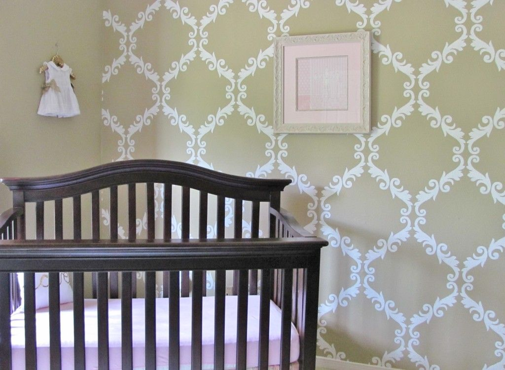 This damask-stenciled wall makes such an impact and totally works for a gender neutral room!