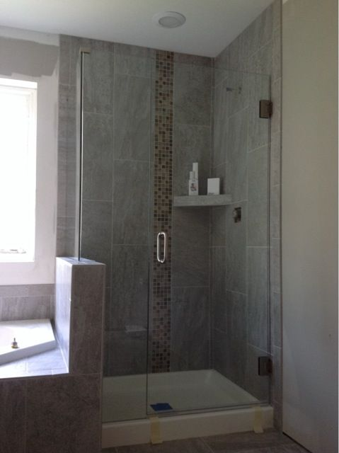 Warm And Inviting Enclosure With Vertical Glass Tiles Creates A Unique And Charming Space Fr Frameless Shower Enclosures Style Tile Shower Enclosure