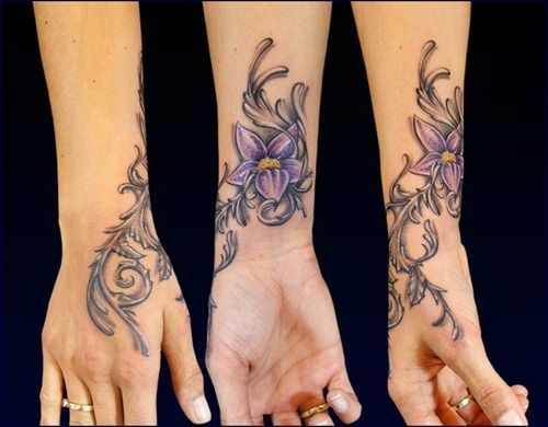 Purple flower tattoo on hand